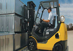 yellow forklift moving outside