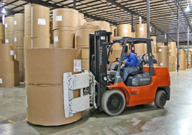 orange forklift warehouse carrying